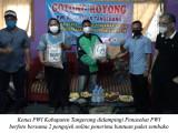 PWI Bagikan Bantuan Paket Sembako Kepada Ojol & Warga