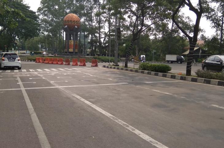Perubahan arus lalul intas di Simpang Tugu Adipura di Pusat Kota Tangerang selama 3 hari tanpa lampu merah hanya bersifat sementara.